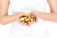 Bride holding coins Royalty Free Stock Image