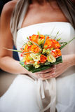 Bride holding colorful bouquet Royalty Free Stock Images