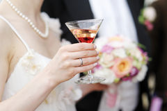 Bride holding a colorful cocktail Royalty Free Stock Images