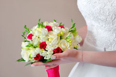 Bride holding colorful flowers bouquet with her hands on wedding Royalty Free Stock Image