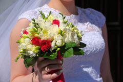 Bride holding colorful flowers bouquet with her hands on wedding Royalty Free Stock Photography