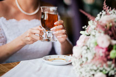 Bride holding the cup of tea Stock Photography