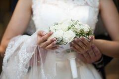 Bride is holding  cute elegant exquisite wedding bouquet Stock Photography