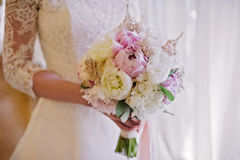 Bride holding delicate marriage bouquet Stock Image