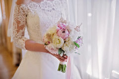 Bride holding delicate marriage bouquet Royalty Free Stock Image