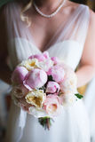 Bride is holding delicate pink bridal bouquet Stock Images