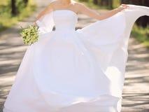 Bride Holding Dress Royalty Free Stock Image