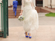 Bride Holding Dress Tail Royalty Free Stock Image