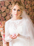 Bride holding earrings Royalty Free Stock Images