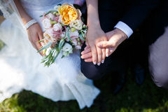 Bride holding floral bouquet Royalty Free Stock Images