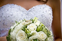Bride holding flower bouquet with wedding rings Royalty Free Stock Photo