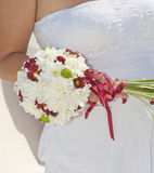 Bride holding a flower posy. Closeup detail of a bride holding a flower posy Royalty Free Stock Image