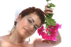 Bride holding flowers. Pretty lady holding red flowers Stock Photography