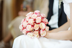 Bride holding flowers Stock Images