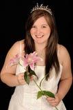 Bride holding flowers Stock Photos
