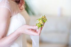 Bride holding flowers Stock Photos