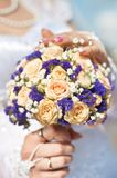 Bride holding  flowers bouquet Royalty Free Stock Images