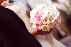 Bride holding flowers bouquet Stock Images