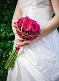 Bride holding flowers Royalty Free Stock Photo