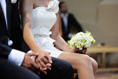 Bride holding flowers at the wedding ceremony Royalty Free Stock Images