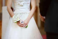 Bride holding flowers at the wedding ceremony Royalty Free Stock Photo