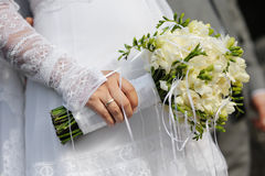 Bride holding freesia flowers Royalty Free Stock Photography