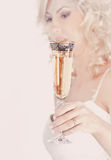 Bride is holding a glass Royalty Free Stock Image