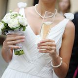 Bride holding a glass of champagne Stock Photo