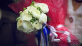 Bride is holding a glass of champagne and bouquet. Of flowers. 1920x1080 stock footage