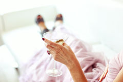 Bride holding a glass of champagne Stock Photography
