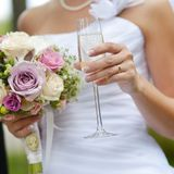 Bride holding a glass of champagne Royalty Free Stock Image