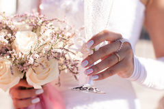 Bride holding a glass of champagne and wedding bouquet Stock Photography