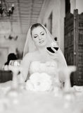 Bride holding glass of vine Stock Photography