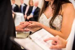 Bride holding Groom`s hand royalty free stock photography