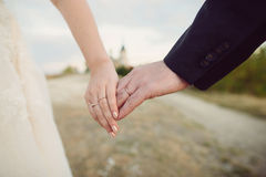 Bride Holding Groom`s Hand Royalty Free Stock Photo