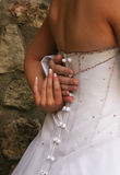 Bride holding grooms hand stock photo