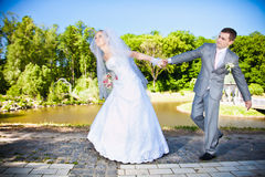 Bride holding grooms hand and leading him Stock Photo