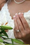 Bride Holding Grooms Ring Stock Image