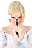 Bride holding the gun Royalty Free Stock Images