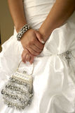 Bride holding handbag Royalty Free Stock Photo