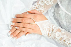 Bride holding the hands on a white wedding dress Royalty Free Stock Photos