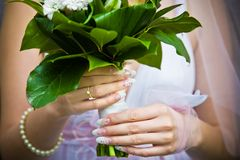 Bride holding her bouquet Royalty Free Stock Images