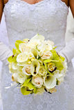 Bride holding her bouquet Stock Photography