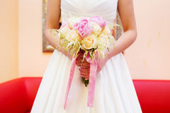 Bride holding her bouquet Stock Images