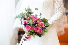 Bride holding her bouquet, closeup royalty free stock image