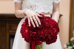 Bride holding her bouquet, closeup royalty free stock photos