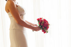 Bride bouquet. Bride holding her bouquet of red roses Stock Photos
