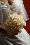 Bride holding her bridal bouquet Royalty Free Stock Images