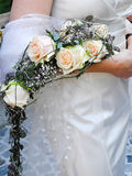 Bride holding her bridal flower bouquet Royalty Free Stock Photography