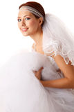 Bride holding her dress Stock Photography